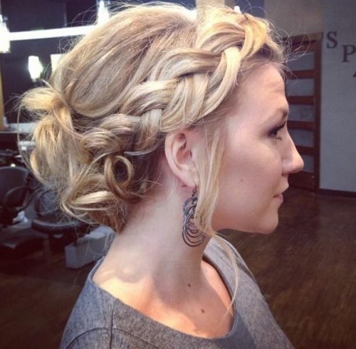 messy curly updo with a crown braid
