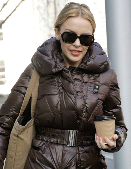 Kylie Minogue hairstyles 2014: street style low bun