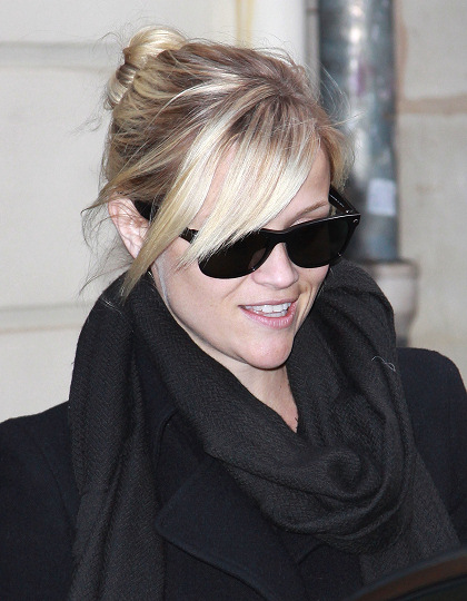 Reese Witherspoon hairstyles 2014: street style bun with bangs