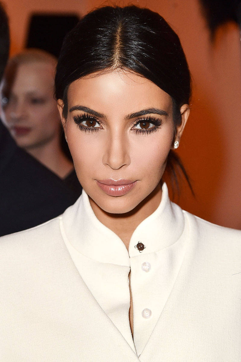 Kim Kardhashian center parted hairstyles 2015