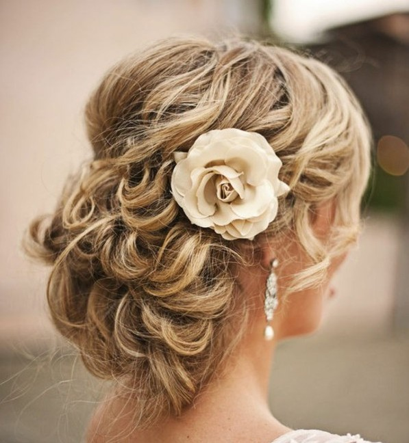 Bridal Updo hairstyles 2015 with flower hair accessories