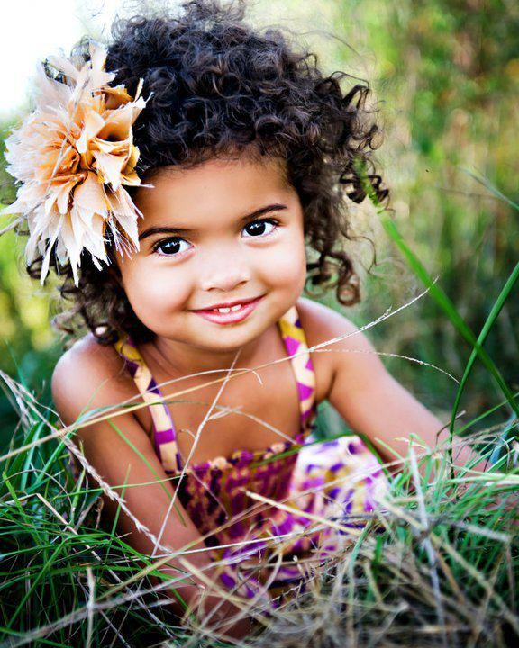 black girls curly hairstyles and a flower