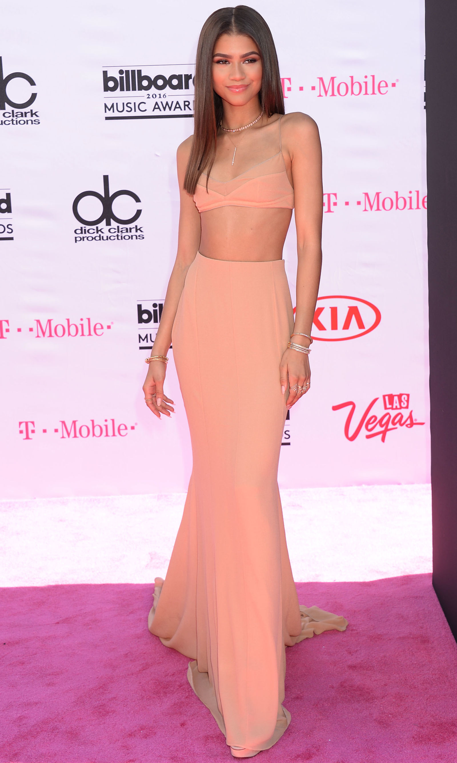 Zendaya center parted long hairstyle