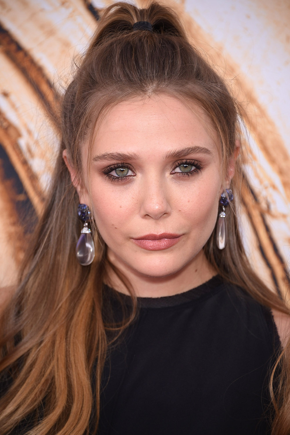 2016 CFDA Fashion Awards - Elizabeth Olsen half bun hairstyle