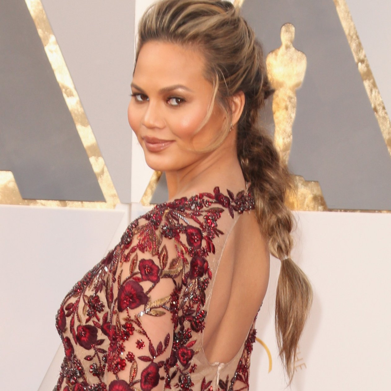 Chrissy Teigen messy braids hairstyles at Oscars